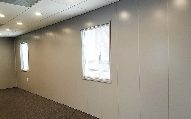 Modular Office Finished with Vertical Powder Coated Metal Panels